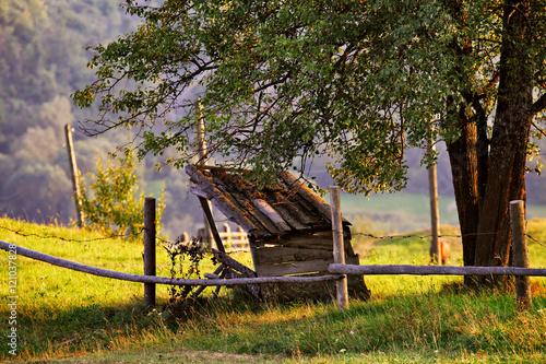 Fotobehang Zwavel geel September rural scene in mountains. Authentic village and fence