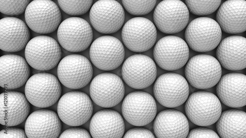 Valokuva  An ordered array of golf balls under neat studio lighting.