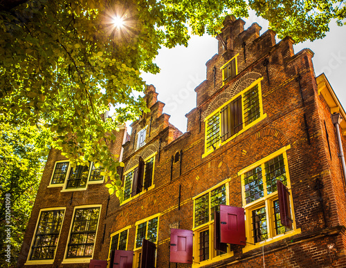 AMSTERDAM, NETHERLANDS - AUGUST 15, 2016: Famous buildings of Amsterdam city centre close-up Wallpaper Mural