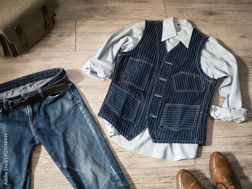 4e0444256b6c2 Top view - Vintage male clothing ( Shirt , Navy vest , jeans )and  accessories