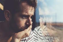 Sad Young Man Looking Through ...
