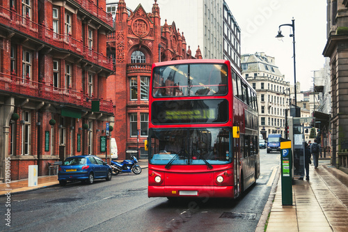Double-decker bus in Birmingham, UK плакат