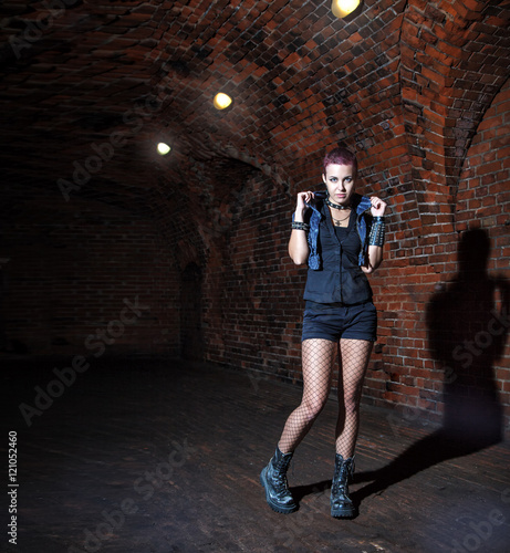 Printed kitchen splashbacks Artist KB punk girl standing in the dark corridor