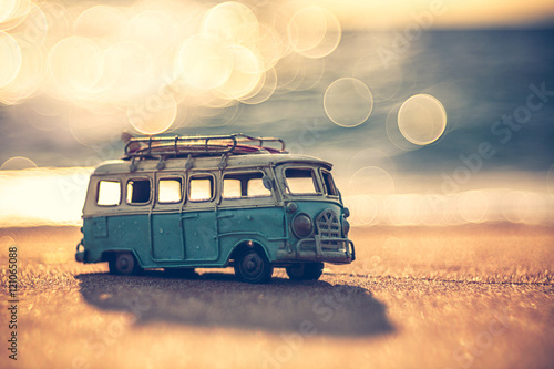 Vintage miniature van in vintage color tone, travel concept