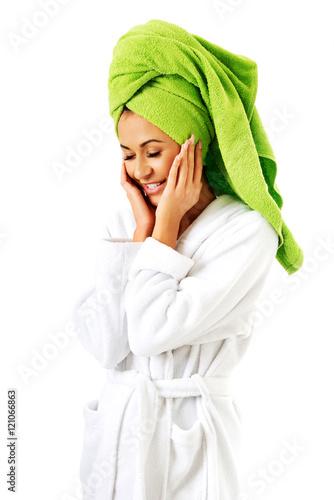 Fotografie, Obraz  Woman in bathrobe and towel on head