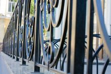 Black Iron Rod. Wrought Fence. The Pattern Of Bars