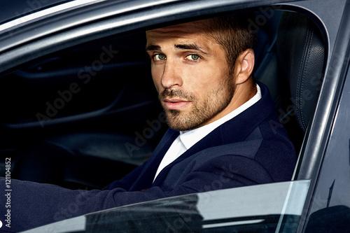 Fotografie, Obraz  Handsome man in the car. Luxury life.