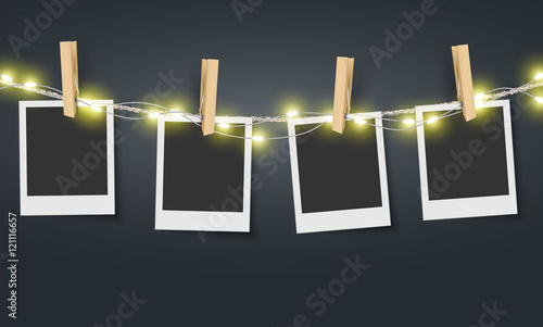 Obraz Blank photo frame hanging on rope with fairy lights Vector - fototapety do salonu