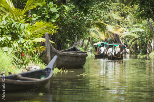 Unidentified indian people in small boat in Kerala backwaters. Canvas Print