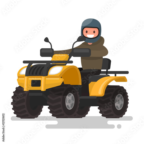 Active holidays. Quad biking. Man in a helmet is riding a yellow