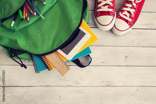 Fototapeta School backpack on wooden background obraz