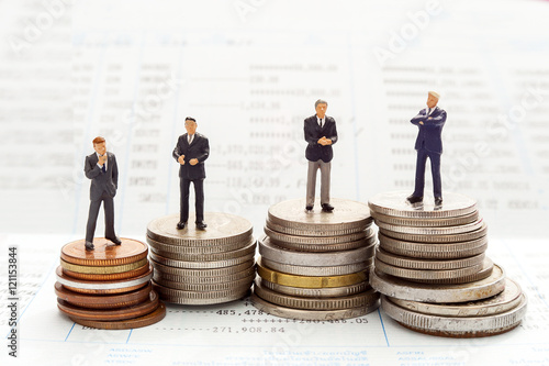 Business people over money background , miniature people business man concept Wallpaper Mural