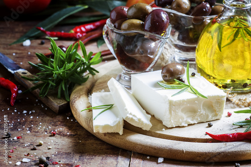 Soft greek feta cheese with rosemary, olives and butter, selecti