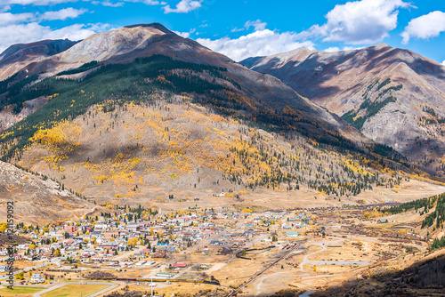 Fotografie, Obraz  Aerial view of Silverton, Colorado in the fall with coal train and smoke with mo