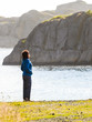 Woman tourist looking at ocean in Norway