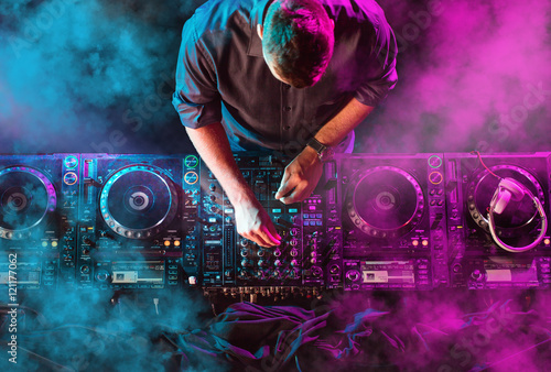 Charismatic disc jockey at the turntable Wallpaper Mural