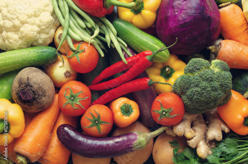 Many fresh vegetables as background, assortment of raw vegetables close up