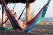 relaxed woman laying in hammock