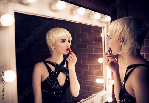 Photo  Beautiful Blonde Woman Looking Into A Mirror At Herself And Appl