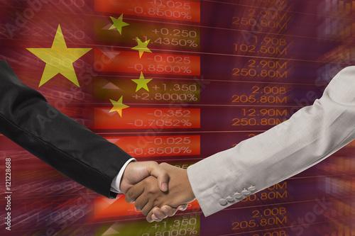 businessmen handshake after good deal in front of china flag Wallpaper Mural