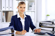 Modern business woman or confident female accountant in office