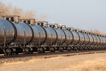Line Of Tank Cars Into Distance