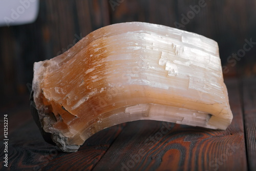 Fotografia, Obraz  Crystal of Selenite isolated on wooden background