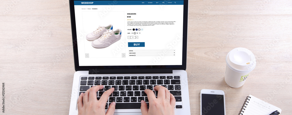 Fototapeta Top view business woman buying sneakers on ecommerce website