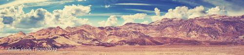 Vintage toned panoramic view of mountain range in Death Valley, USA.