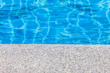 Pool Edge Concrete With Blue Water