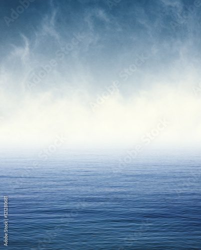 Keuken foto achterwand Zee / Oceaan Fog on Blue Ocean. Fog and clouds hovering over the Pacific ocean. Image displays a pleasing paper grain and texture at 100%.