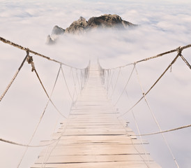 Fototapeta Mosty rope bridge with wood planks in the sky