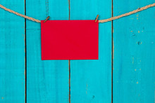 Blank Red Sign Hanging On Rope