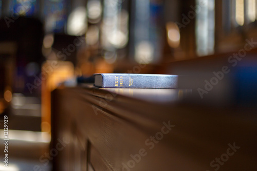 Bible and other books in church Canvas Print