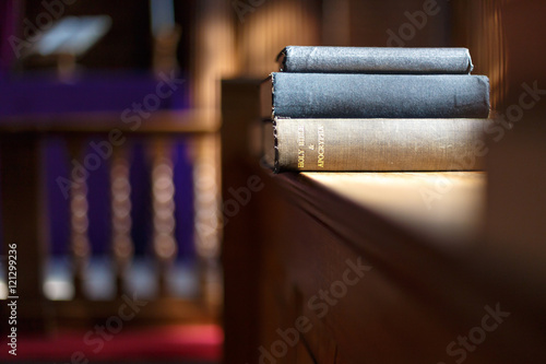 Bible and other books in church Wallpaper Mural