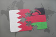 puzzle with the national flag of bahrain and malawi on a world map background.