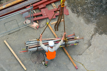 Builder Manages The Construction Process Of Crane Hook Lifting W