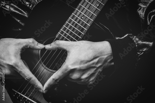 Obrazy muzyczne  music-lover-male-hand-sign-on-acoustic-guitar-bw-filter