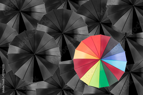 Spoed Fotobehang Luchtsport Holding colorful umbrella for saving money.