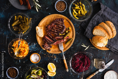 In de dag Grill / Barbecue Dinner party with barbeque beef meat and fermented pickled vegetables.