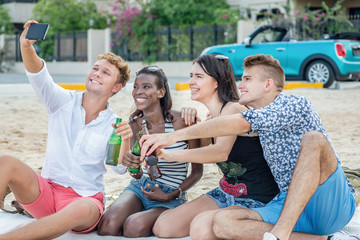 Friends doing selfie. Group of young cheerful people having fun