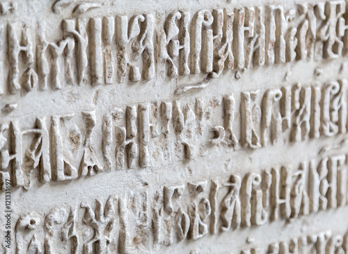 Fotografie, Obraz  Old Cyrillic Script Letters In Stone