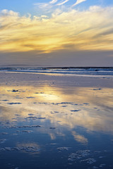 yellow reflections and calm waves
