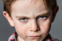 Mad Little Kid With Furious Blue Eyes For Childhood Rebellion