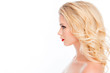 Leinwanddruck Bild - Side view portrait of beautiful blonde with modern hairstyle