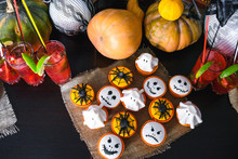 Group Of Halloween Cupcakes With Pumpkin And Cocktails Background