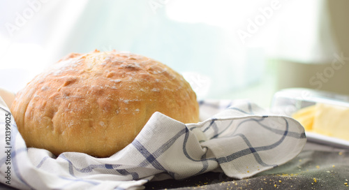 Foto auf Gartenposter Brot perfect fresh baked sourdough bread with butter on the side