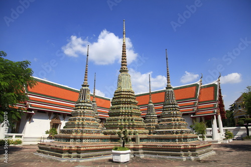 Stupas at Wat Pho temple in Bangkok Poster