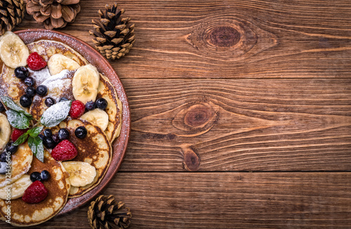 Fotografie, Obraz  Pancakes with fresh fruit for breakfast, top view.
