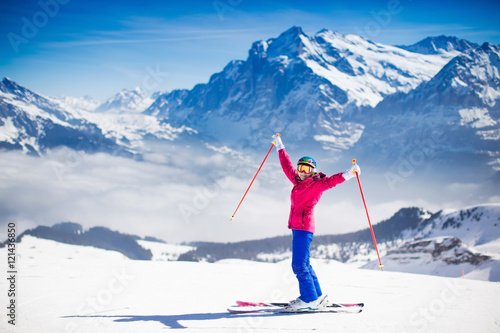Garden Poster Winter sports Young woman skiing in the mountains.